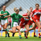The Louth defence can only watch as Rebecca Delee of Limerick shoots to score her side's second goal during the G4All-Ireland Junior Championship Final at Croke Park. Picture: Sportsfile