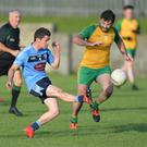 Fiachre Sheridan of Glyde Rangers drives the ball forward as Thomas Campbell challenges for Stabannon