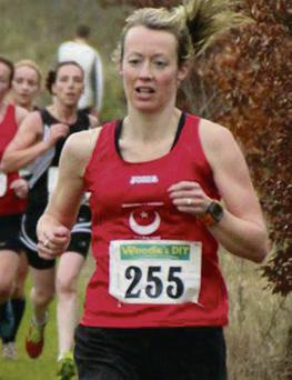 Mary Leech winning the Masters 3k cross country race