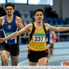 Kevin McGrath, Bohermeen AC, celebrates as he crosses the finish line ahead of second placed Andrew Coscoran, Star of the Sea AC, left, during the Junior Men's 1500m event. GloHealth National Indoor Junior & U23 Championships, Athlone International Arena, Athlone