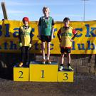 Under-13s Tiernan Rowley and Calum Sheedy on the podium for Boyne AC