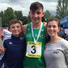 Schools gold medallist Liam Connaughton is congratulated by his brother Seán and sister Niamh
