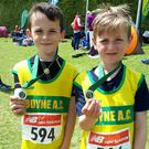 Alex Robertson and Lorcan Forde Dunne show off their medals at the Leinster Championships