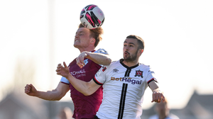 Drogheda United's Daniel O'Reilly heads clear from Michael Duffy of Dundalk. Pictures: Sportsfile