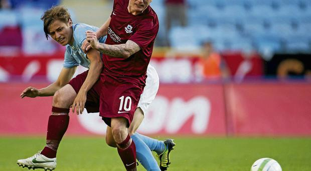 Gary O'Neill tussles with 20-year-old Swedish international Simon Thern