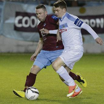 Drogheda's Philip Hand tracks the run of Dean Clarke.
