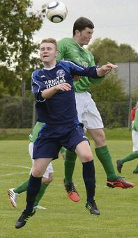 Aidan Bissett rises highest to head clear for Duleek during their FAI Junior Cup tie against Hardwicke.