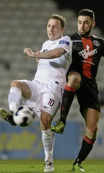 Drogheda United's two-goal hero Gary O'Neill shields the ball from Roberto Lopes. Picture: Matt Browne/Sportsfile
