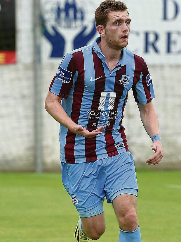 New Drogheda signing Peter McGlynn in action during the friendly against Warrenpoint Town at United Park on Saturday afternoon.