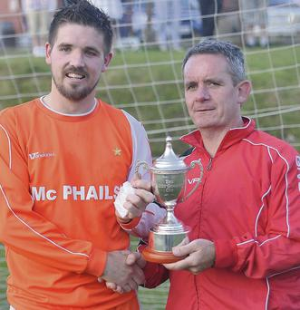 McPhails captain Alan Connor collects the Paddy Goodwin Cup from the Drogheda Summer League's Keith Wallace (above) and (left) the beaten finalists Carranstown Lodge from Duleek