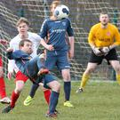 Paul Clarke sets himself to attempt an overhead shot on goal during Sunday's game between Ardee Celtic and Rock Celtic