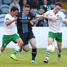 Drogheda's Richard Purdy looks for a way through Cabinteely's Shane Boyle and Ben Hanrahan