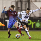 Dylan Connolly of Dundalk in action against Conor Kane of Drogheda during the Malone Cup clash at Oriel Park
