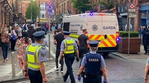 Gardaí move people on from South William Street, Dublin, on Sunday, May 30, 2021. Photo: Niall Carson/PA Wire