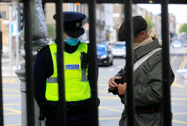 A man is taken to Store Street garda station during an event marking the centenary of the burning of the Custom House. Photo: Gareth Chaney/Collins