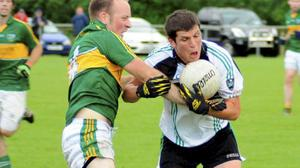 Niall Collins of St Patrick's Donabate in his younger days battling with Clann Mhuire's Martin McManus.
