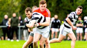 Ravens' Caolmhin O'Scannail under mounting prerssure from Conan Brady of Fingallians during the Senior 2 FC Relegation Final at Naul.
