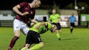 Sean Murray, Ardmore Rovers, tries to get the better of Swords Celtic's Lewis Skelly.