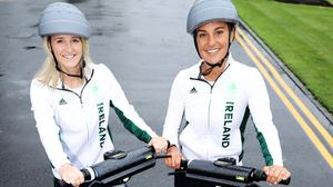 Irish Olympic hockey players Nicola Daly and Lena Tice trying out the e-scooters for the first time