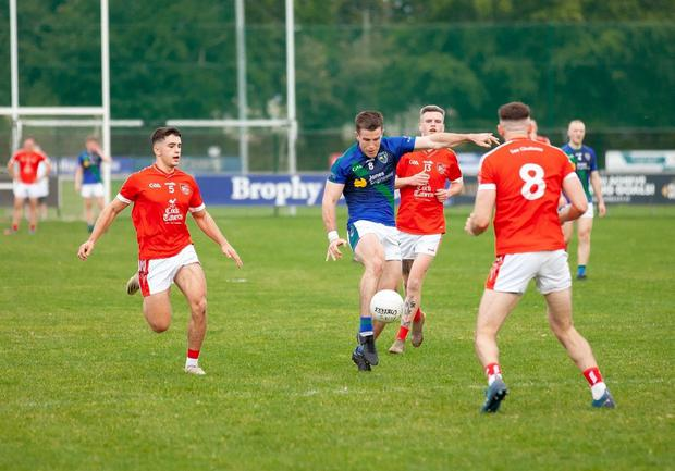 Dylan Connolly gets his pass away for St Sylvester's against Fingallians. Picture: Eamonn Smyth Photography