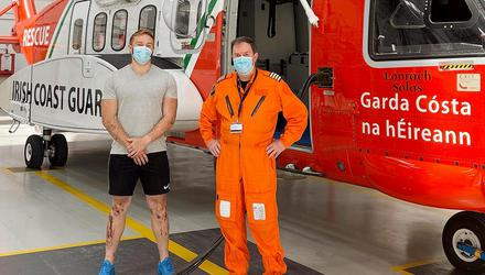 Jack Eoin Rua O'Neill with Captain Jim Kirwan, the Coast Guard helicopter pilot involved in his dramatic rescue in Howth. Pic: Irish Coast Guard