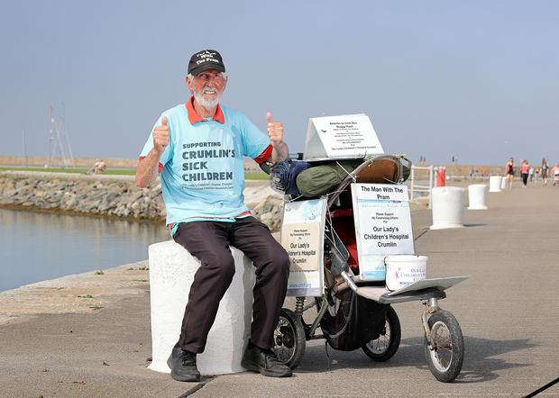 Seventy eight year old Eugene O Leary pictured on the East Pier in Howth where he finished his 250 K walk pushing a buggy from Sligo to Dublin to raise money for Crumlin Children's Hospital.Picture Credit:Frank McGrath
