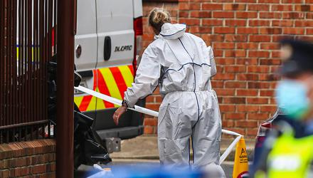29/04/21 - Members of the Garda technical forensic bureau work at the scene following the discovery of a man's body in a flat at Robinson's Court, off Cork Street in south inner city Dublin on Thursday. Photo: Damien Storan.