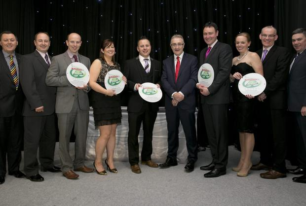 Ciaran Price and Patrick Rooney of Bunclody Eurospar, far left, with fellow winners Lorraine Kelly, Derek Downes, John O'Neill, Joan Howley and Peter Walkin and, fourth from right, BWG Group CEO Leo Crawford