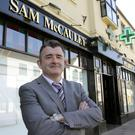 Sam McCauleys MD Patrick McCormack outside the store in Redmond Square