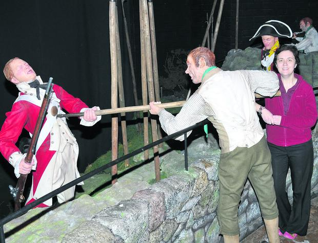 n Jacqui Sidney-Hynes, manager of the National 1798 Centre, beside one of the lifesize, and life-like, battle scenes.