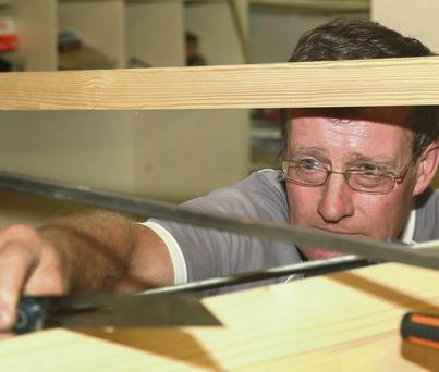 Fintan Kinsella, pictured crafting a 'Slaney Cot'.