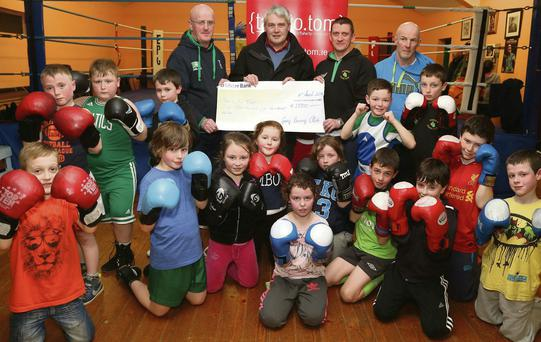 Ray Cullen of Talk to Tom accepting the cheque from Gorey Boxing Club coaches Aidan Daly, Dara Kinsella and John Murray.