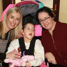 Lisa Cullen and Ava Watchorn with her mother Marie Farrell at the Christmas craft fair in Kiltealy Community Centre