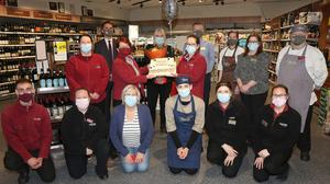 Staff members at Pettitt's SuperValu in Enniscorthy making a presentation to retiring manager Roseleen Casey