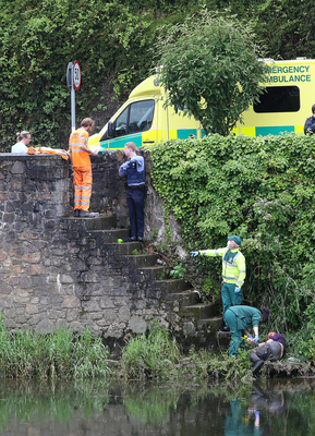 Ambulance and garda personnel attend to a man in an incident near the new bridge in Enniscorthy on Thursday afternoon