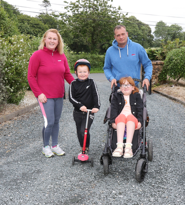 Mia-Lily and Lorcan Ruttle from Caim, heading out again, on their 100k Wheel Challenge for Enable Ireland, along with their parents Ailish and Trevor