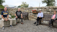Shay Bowe (chairman), Jim Kirwan, Des Farrell (secretary) and Mary Breen in the Memorial Garden in Kiltealy village