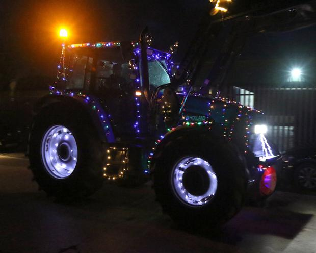 A tractor lit up with fairy lights for the road run