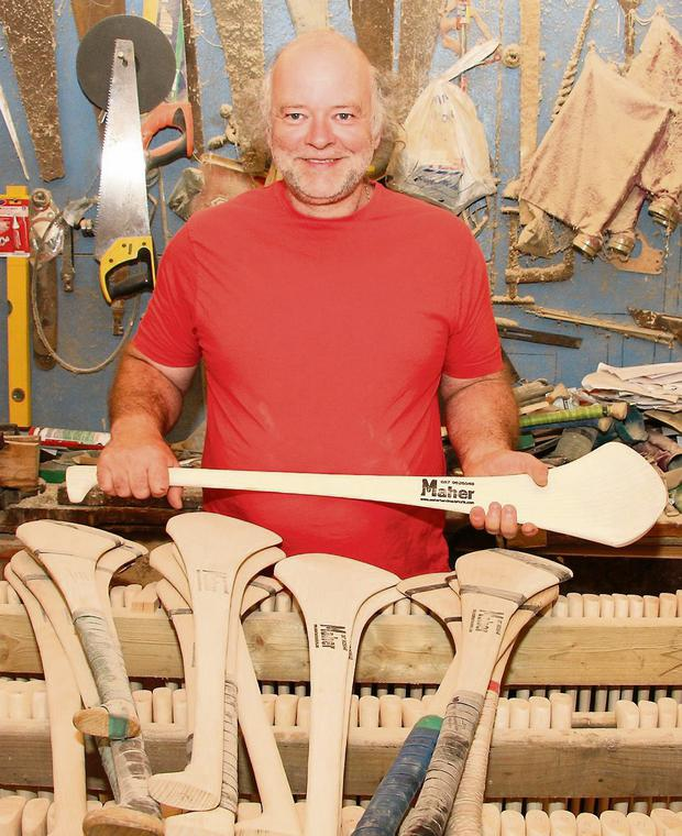 Paul Maher in his workshop with some of his hurls.
