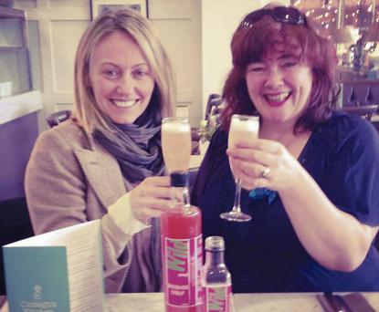 Celebrity chef Clodagh McKenna enjoying a glass of rhubarb syrup with prosecco with Fiona Falconer of Wild About