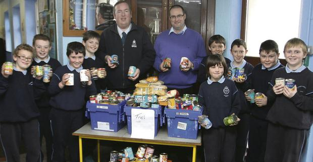Saint Joseph's NS present present food to, Gorey Community Social Services and MWSPCA pictured with chairman, Colin Webb and school principoal, Padraig Cronin.