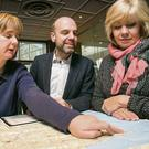 Genealogist Karel Kiely (left), Mark Henry of Tourism Ireland, and prize-winner Mary Powell planning Mary's visit to the homestead of her ancestors in Rosslare.