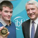 Jason Banville, St Mary's CBS, Enniscorthy, and David Duffy, president of the Irish Banking Federation