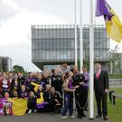 Holly Sinnott Scoil Mhuire and Rhianna Jarrett raise the flag with Cllr Oliver Doyle vice chairman Wexford County Council and Cllr Michael Sheehan as pupils look on.