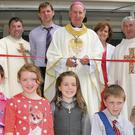 Bishop Denis Brennan cuts the ribbon at the official opening of the new extension at The Ballagh NS watched by (from left) Fr. Dermot Gahan, John Ormonde (school principal), Noreine Kelly, Fr. Paddy Browne and pupils.
