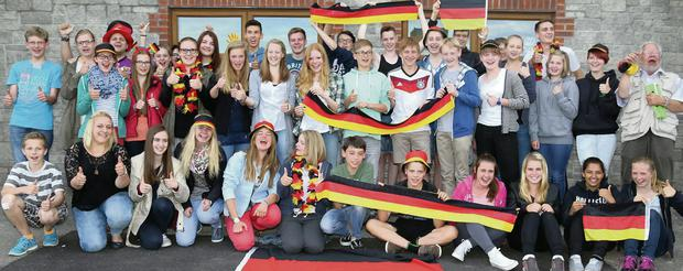 German students pictured at the Naomh Eanna GAA Complex for the World Cup Final, marking the group's 24th annual visit to Gorey.