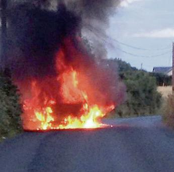 The car on fire. Picture taken by Paul Martin.