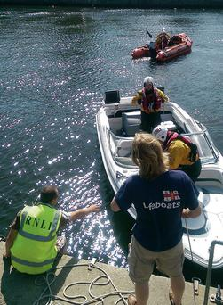 The speedboat is brought to shore by the Courtown RNLI lifeboat.