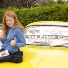 Chloe Byrne with the Ford Mark 1 car that will be raffled during the Gerard Murphy Memorial Vintage and Classic Car Road Run takes place in Ferns on Sunday October 5