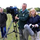 Paddy McInerney with RTE's Helen McInerney and cameraman Declan Barrett. Photo: Tony Maher